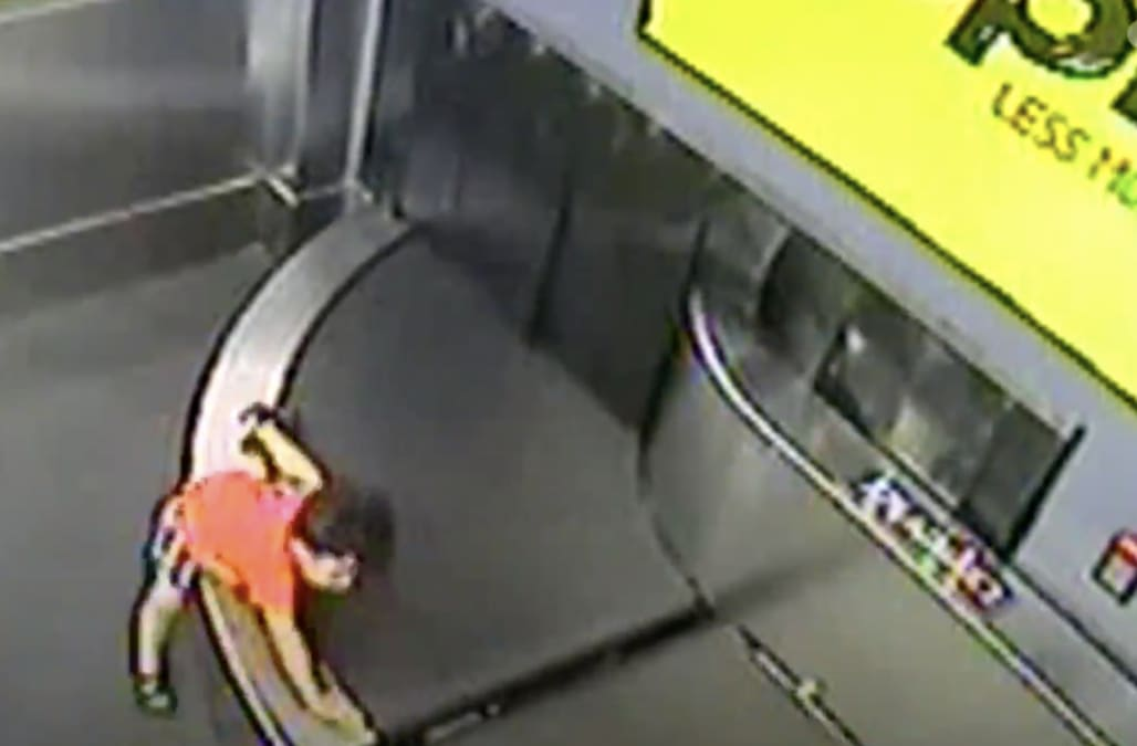 Terrifying moment toddler is swept away on airport conveyor