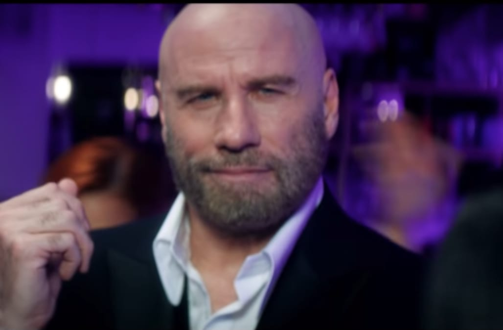John Travolta shows off his sexual dance moves in Pitbull's steamy