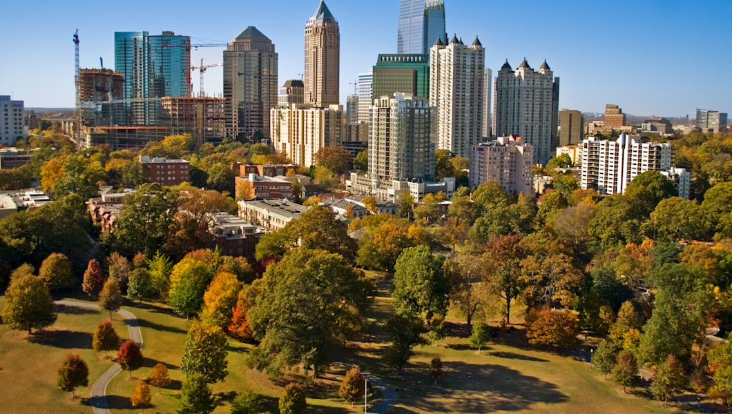 Atlanta skyscrapers as seen by a camera lofted by kite over Piedmont Park.In the foreground, park grass suffers from a drought that started in 2007.