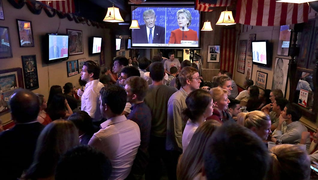 WASHINGTON, DC - SEPTEMBER 26:  Patrons fill the Capitol Lounge two blocks from the U.S. Captiol to watch the first presidential debate between Republican candidate Donald Trump and Democratic candidate Hillary Clinton September 26, 2016 in Washington, DC. The historic one-and-a-half hour debate was broadcast on CNN.  (Photo by Chip Somodevilla/Getty Images)