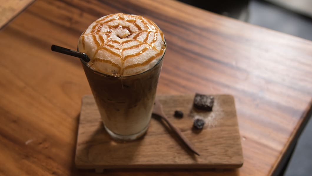 Ice coffee caramel macchiato on wooden table