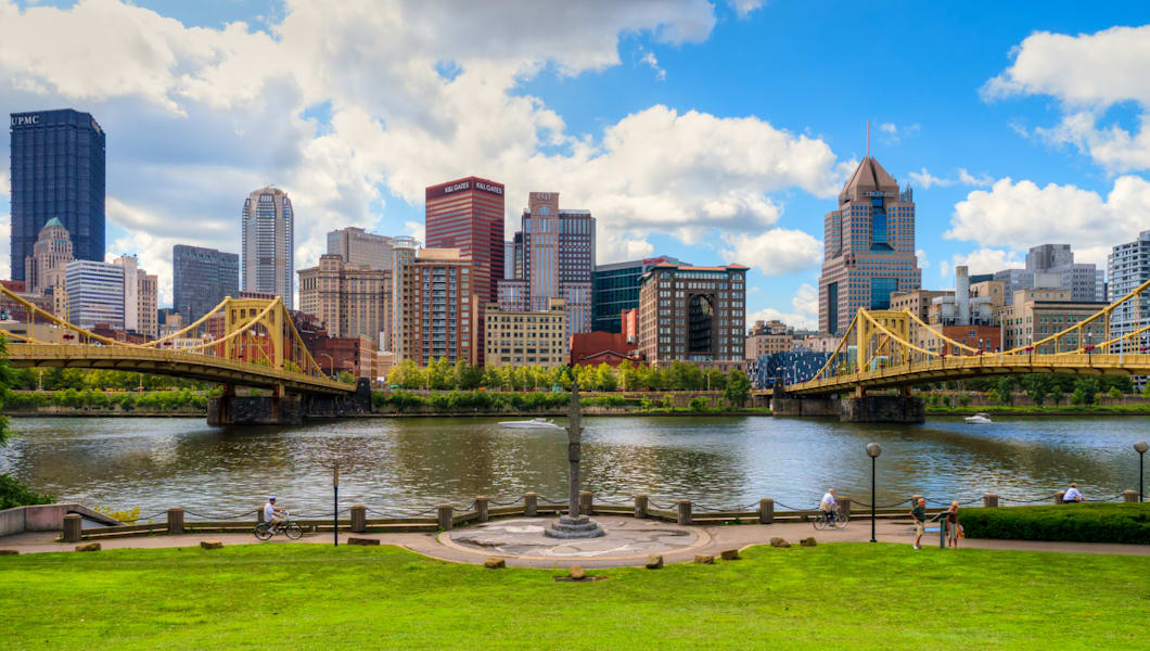 Sunny skyline view of downtown Pittsburgh as seen between the Andy Warhol Bridge and the Roberto Clemente Bridge