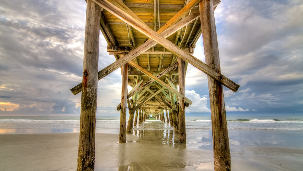 An early-morning view towards the ocean from underneath the Cherry Grove fishing pier, North Myrtle Beach SC.