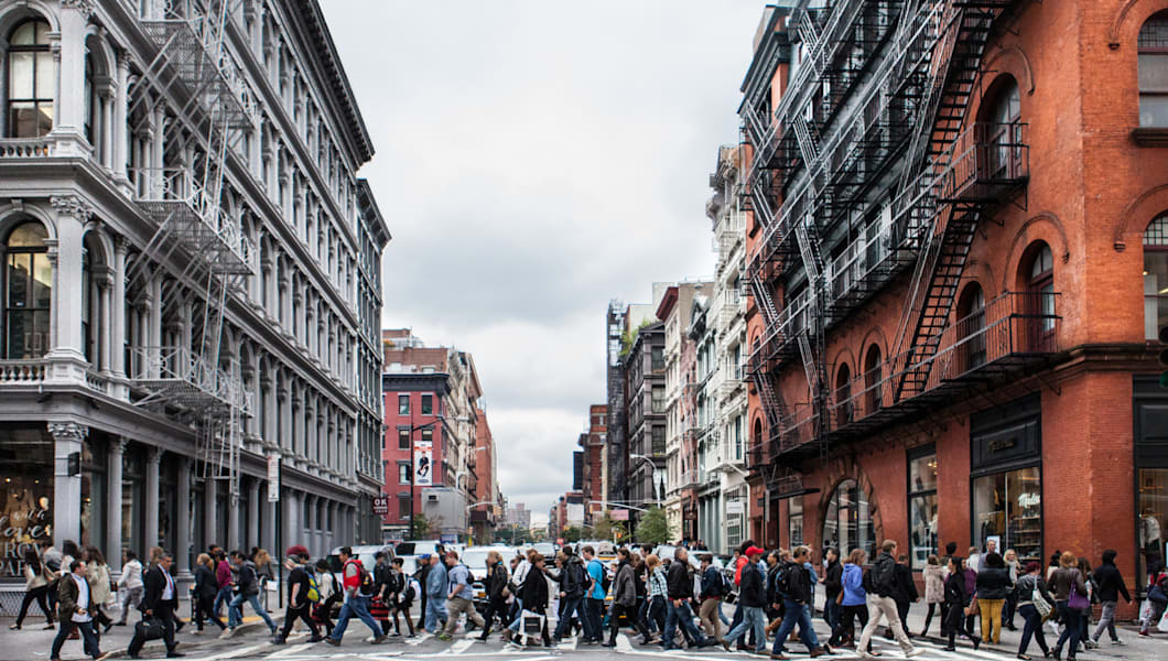 Tourists and shoppers flock to SoHo, New York City.