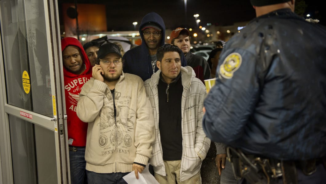 Early morning shoppers wait to be let into Best Buy at 5:00 a.m. in Atlanta Friday, Nov. 26, 2010 hoping to snag a deal on Black Friday.  (AP Photo/Rich Addicks)