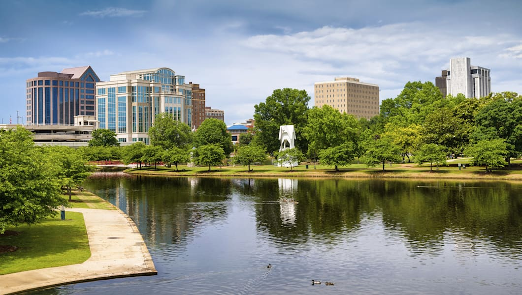 Cityscape scene of downtown Huntsville, Alabama, from Big Spring Park during the day