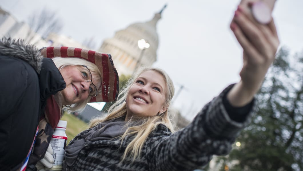 UNITED STATES - JANUARY 20: Kitty Tinsley, left, and Stephanie Glantz, from Carson City, Nev., take a selfie on the West Front of the Capitol on Inauguration Day before Donald J. Trump was sworn in as the 45th President of the United States, January 20, 2017. (Photo By Tom Williams/CQ Roll Call)