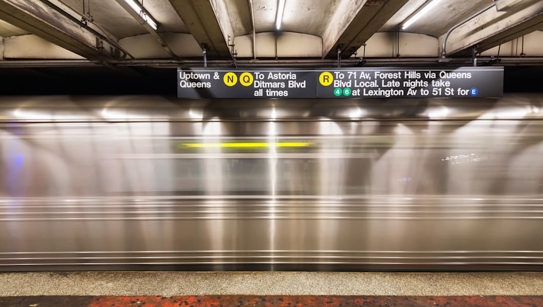 NEW YORK CITY, USA  - NOVEMBER 18, 2014 : An empty track of New York City subway when train passes by.