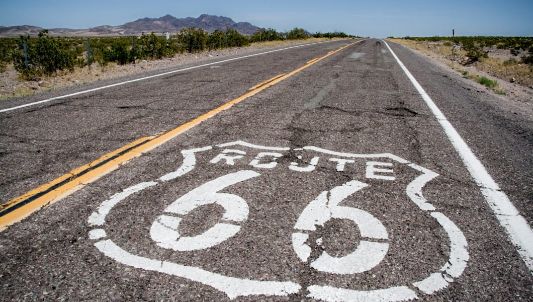 long road with a route 66 sign...