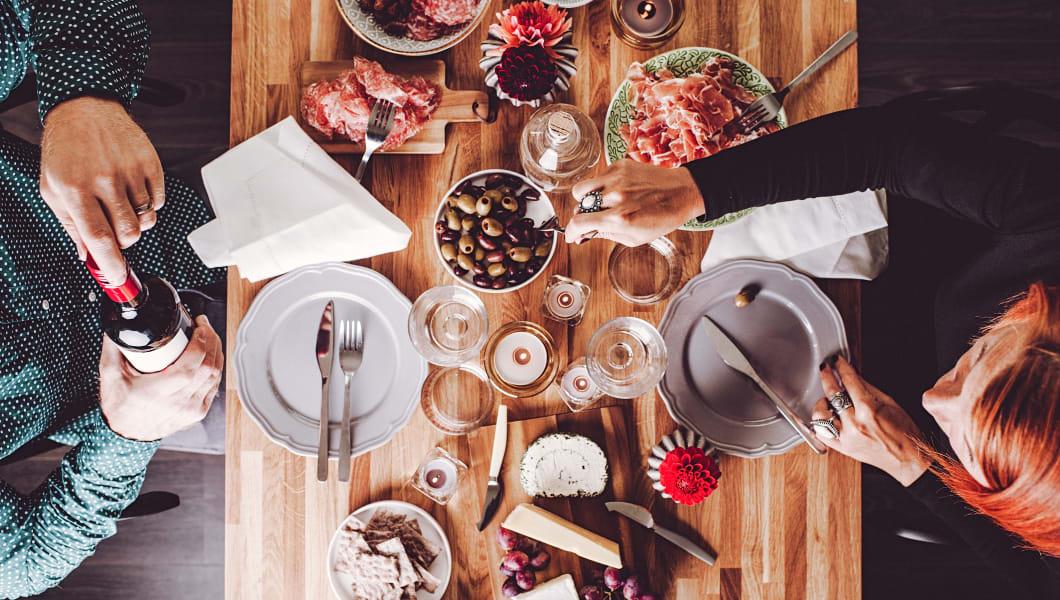 People having wine dinner overhead table top view