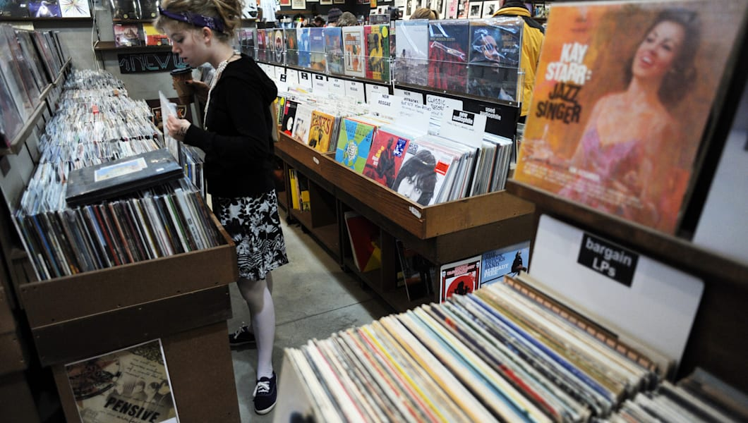 Joy Laub, 16, of Denver is checking the records at Twist & Shout in Downtown Denver on Saturday. The remaining independent record stores around the country is celebrating their survival with parties and performances in stores throughout the country. Hyoung Chang, The Denver Post  (Photo By Hyoung Chang/The Denver Post via Getty Images)