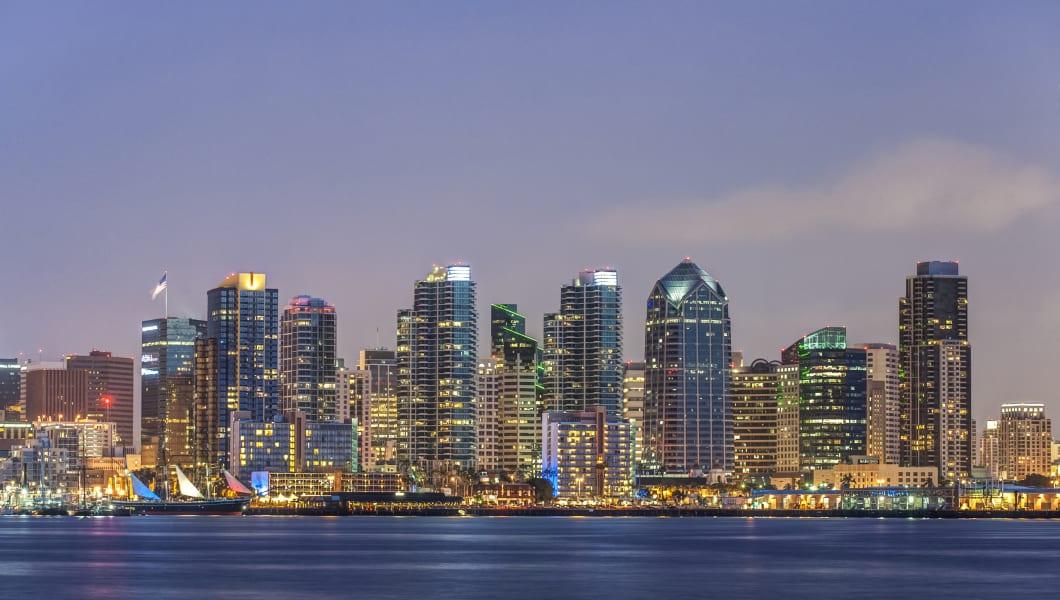 City skyline lit up at night, San Diego, California, United States