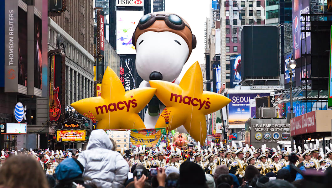MANHATTAN - NOVEMBER 25 : cartoon character balloon passing Times Square at the Macy's Thanksgiving Day Parade November 25, 2010 in Manhattan.