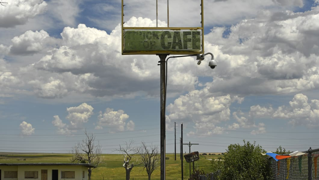 CABIN CREEK, CO - JULY 6: The old sign for the Cabin Creek cafe is still standing on the 5 acre piece of land that makes up what is now a ghost town on the eastern plains  on July 6, 2016 in Cabin Creek, Colorado. The town near Byers, used to have a running cafe, a motel, a caretaker's house, a gas station and movie theater.  The buildings are still there but not open. Owner James Johnson has owned the parcel twice and is looking to sell it to a very special buyer for $350,000.  He would like someone to restore it to it's heyday of the 1950's and 1960's.  He calls it a 'Route 66' type of town with all of it's quirks. (Photo by Helen H. Richardson/The Denver Post via Getty Images)