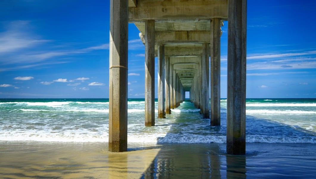 Amazing perspective under the Scripps Pier at La Jolla Shores beach in San Diego, California.