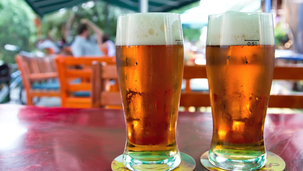 Two beers on table in the garden pub.