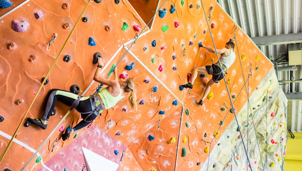 fit couple rock climbing...