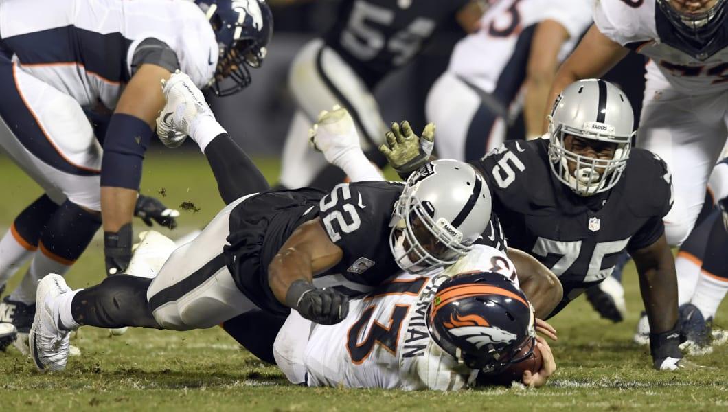 OAKLAND, CA - NOVEMBER 06: Oakland Raiders defensive end Khalil Mack (52) puts a big hit on Denver Broncos quarterback Trevor Siemian (13) for a sack during the third quarter November 6, 2016 at Oakland-Alameda County Coliseum. (Photo By John Leyba/The Denver Post via Getty Images)