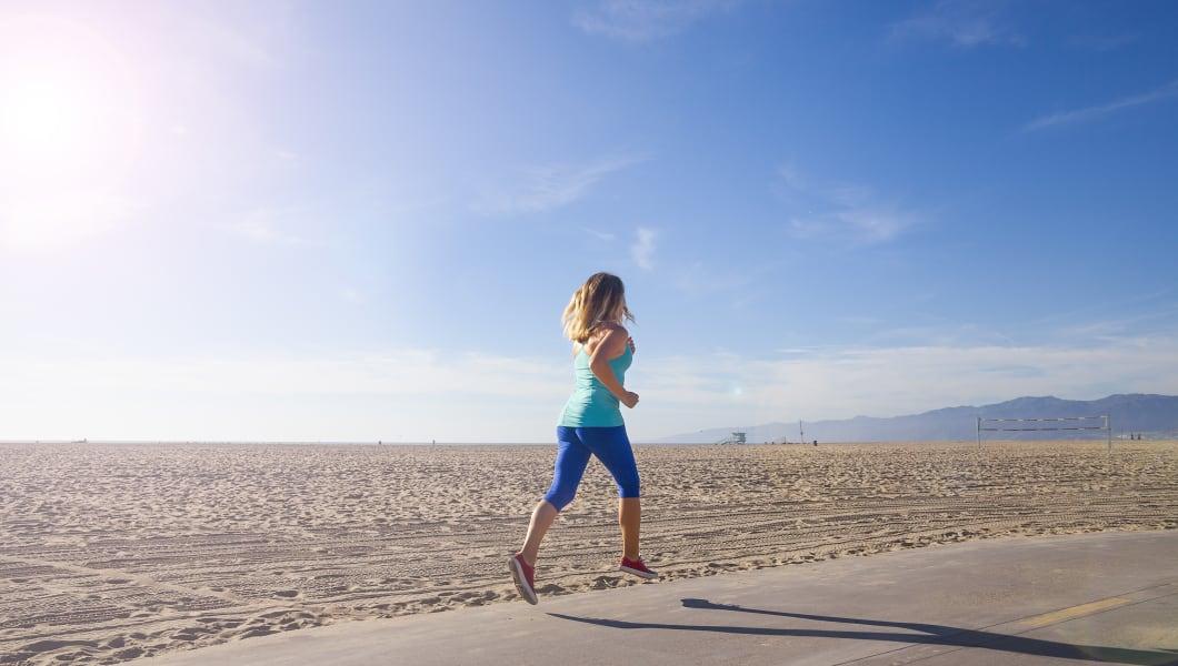 Woman running / Exercising at Venice  and Santa Monica Beach California