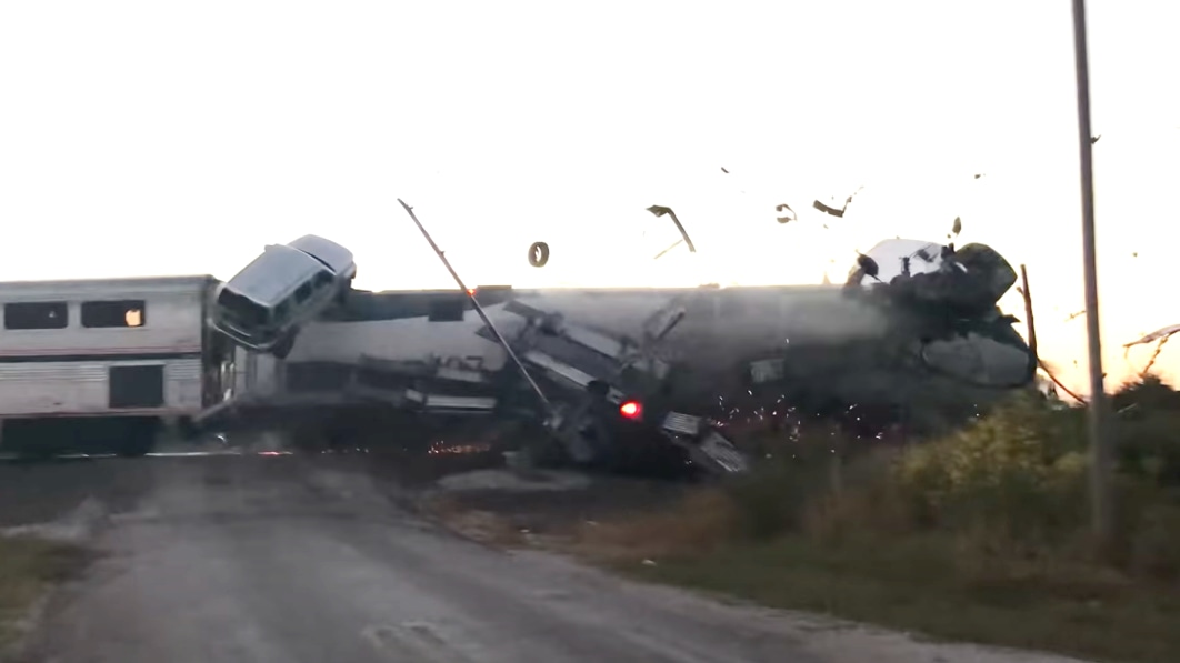 Watch automobiles go flying in terrifying prepare crash with automotive hauler