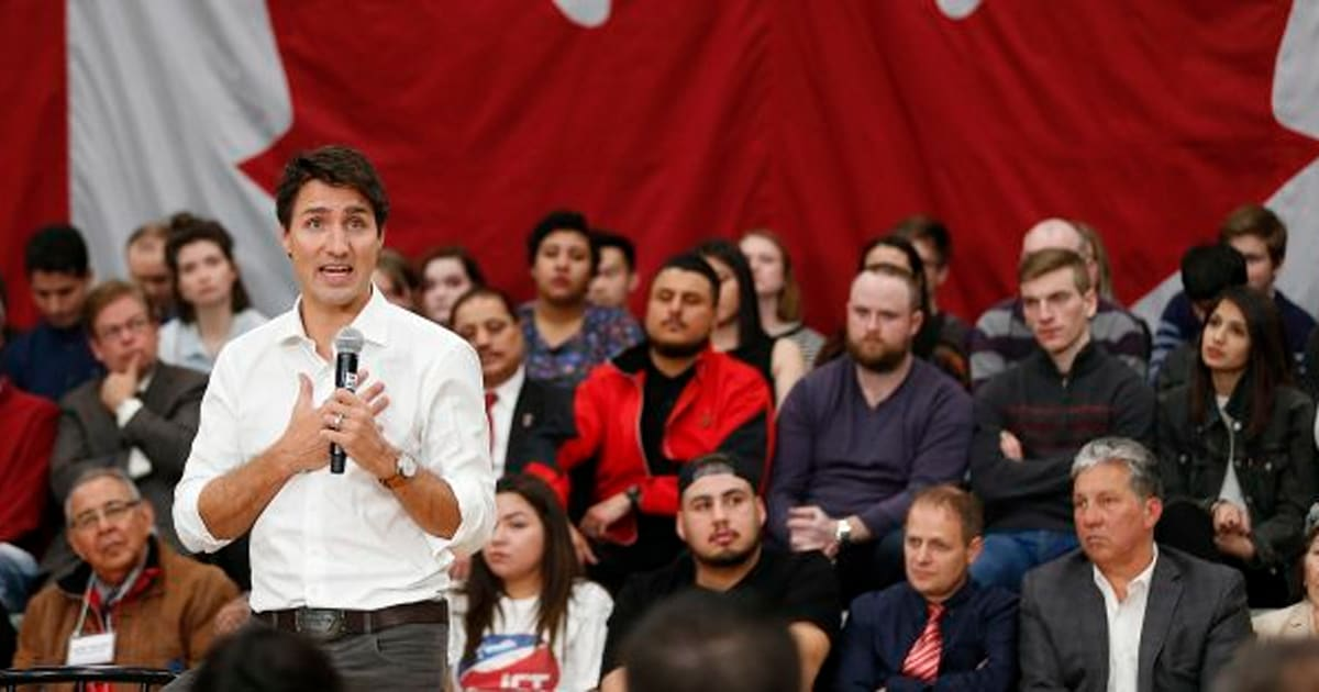 Indigenous Elder Calms Protesters Heckling PM Trudeau At Winnipeg Town Hall