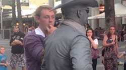 WATCH: Human Statue Punches Man And Other Top Viral