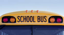 School Bus Rolls Into