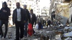Des civils évacués de Homs après un accord entre le régime syrien et les