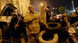 Ukraine: le chaos s'étend alors que Poutine menace les sociétés