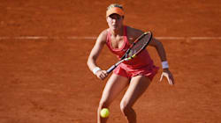 Eugenie Bouchard, Milos Raonic Advance To Fourth Round At French