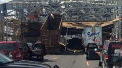 LOOK: Dump Truck Collides Into Bridge In