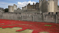 LOOK: A Sea Of Ceramic Poppies Surrounds Tower Of