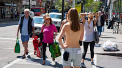 Topless Journalist Walks Around Downtown Montreal