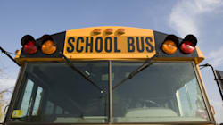 Driver Dead, Students Injured After Bus