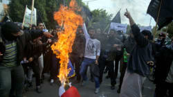 Protesters Burn French Flag To Protest Charlie Hebdo