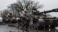 Ukraine: le retrait des armes lourdes est presque