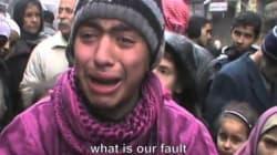 I bambini palestinesi in fuga da Yarmouk in mano