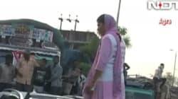 WATCH: Angry Agra Woman Has A Meltdown On The Street After UP Minister's Guard Winks At