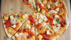 Que tal uma pizza de tofu com rabanetes? Você vai