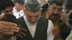 Karzai Weeps Over Slain Brother's
