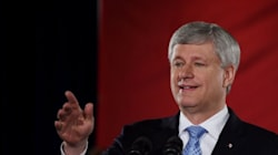 Harper Sneaks In Some Partisan Messaging On Campaign 'Down