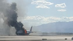 Passengers Seen Taking Luggage From Burning