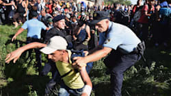 Refugees Break Through Police Lines In