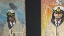 L'artista ritrae i Marò con teschi e fucili. Fassino e Fratelli d'Italia si