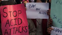 Russian Acid Attack Victim Flies Back