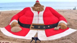 Indian Sand Artist's 45-Foot-Tall Santa Claus Eyes World