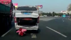 CAUGHT ON VIDEO: Toddler Falls Out Of Moving Van Onto Busy Road In