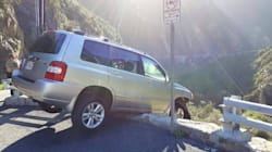 Driver Escapes SUV Dangling From Cliff Only To Be Hit By A