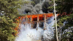 Massive Fire Engulfs CN Rail Bridge Near