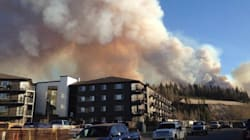 Aircraft And Ground Crews Work To Halt Fort McMurray